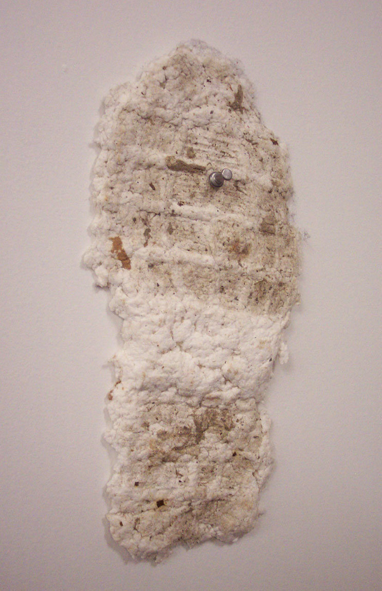 Footprint (detail). 2004. Cast handmade paper and detritus. -