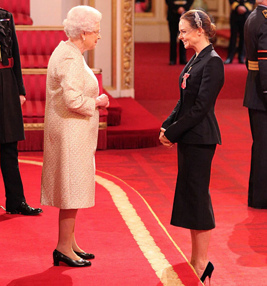 HM The Queen and Stella McCartney at her OBE Investiture