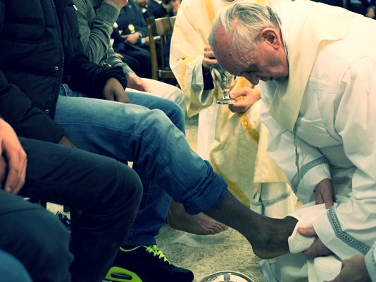 """Washing your feet means I am at your service,"" Pope Francis said to the youth whose feet he washed on Holy Thursday 2013."