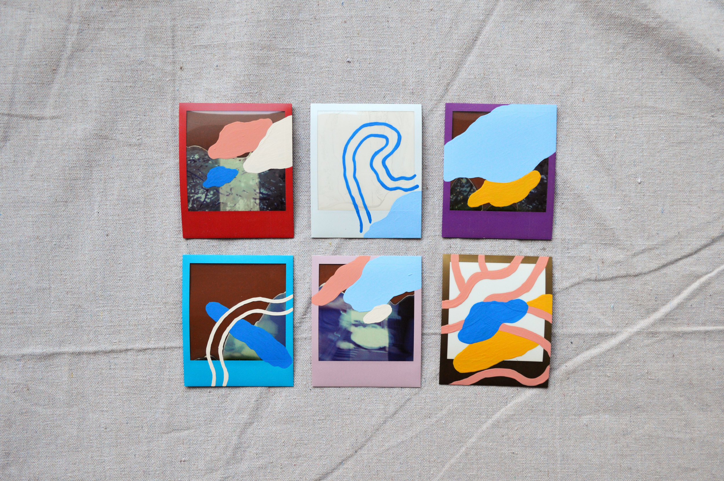 """Everything Is Your Fault, But Really It's Theirs  Left to right, top to bottom: Red, White, Violet, Blue, Lavender, Gold  4.5"""" x 4""""  Paint on Polaroid"""