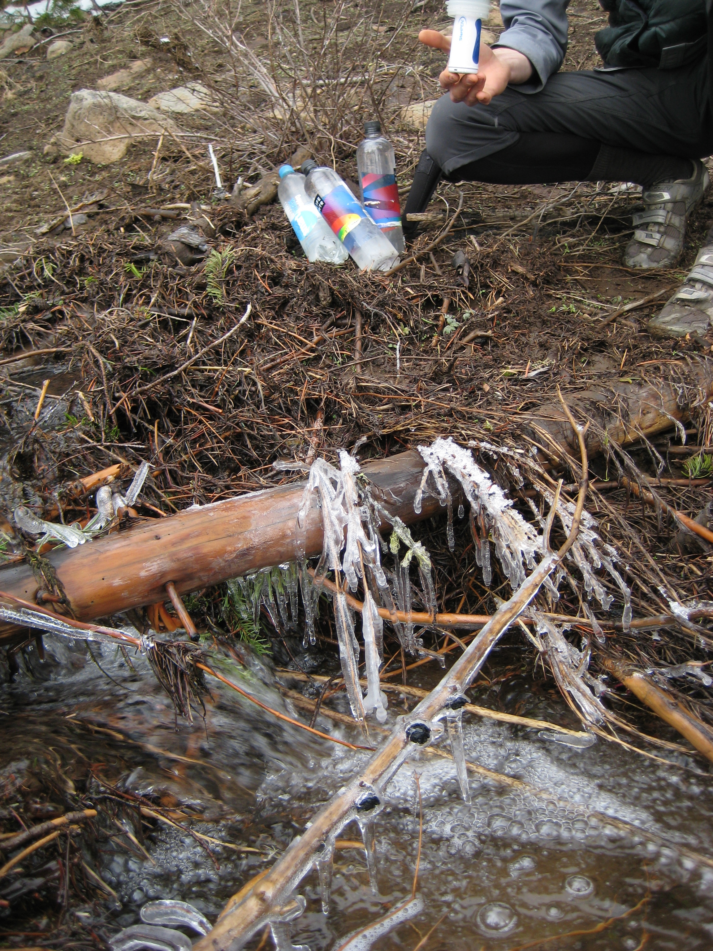 Filtering water from frozen streams.