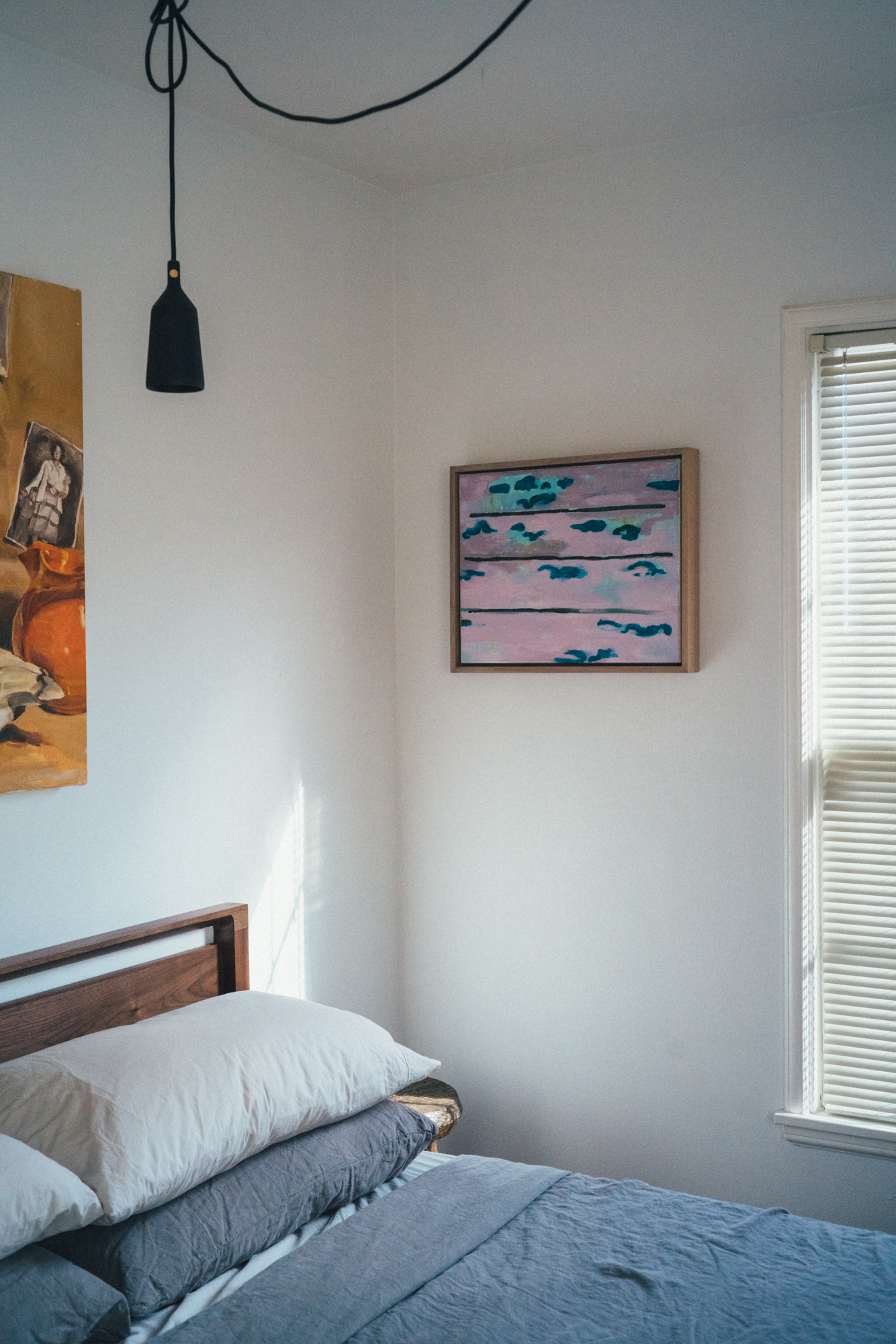 In The Wake , a painting from 2018, photographed in situ. I made the oak frame as well.
