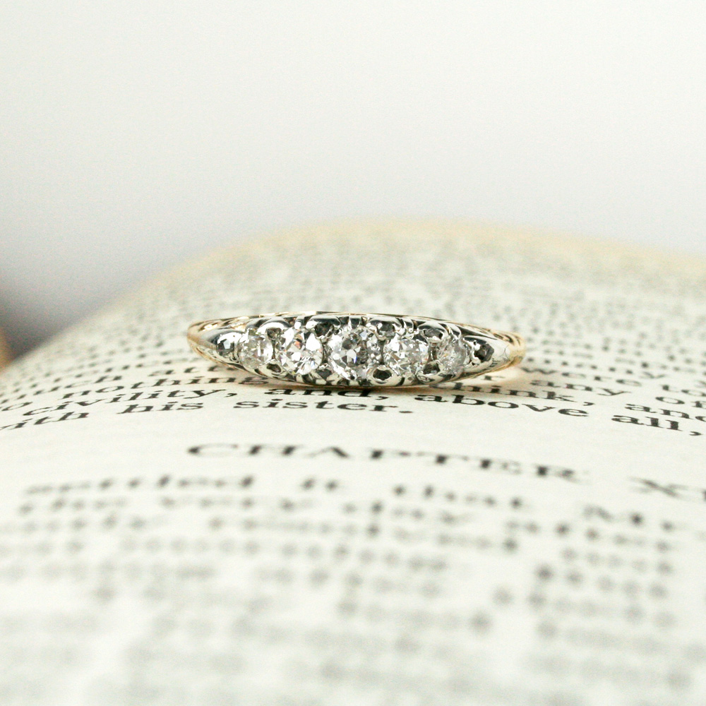 Engraved Victorian 5-diamond ring.