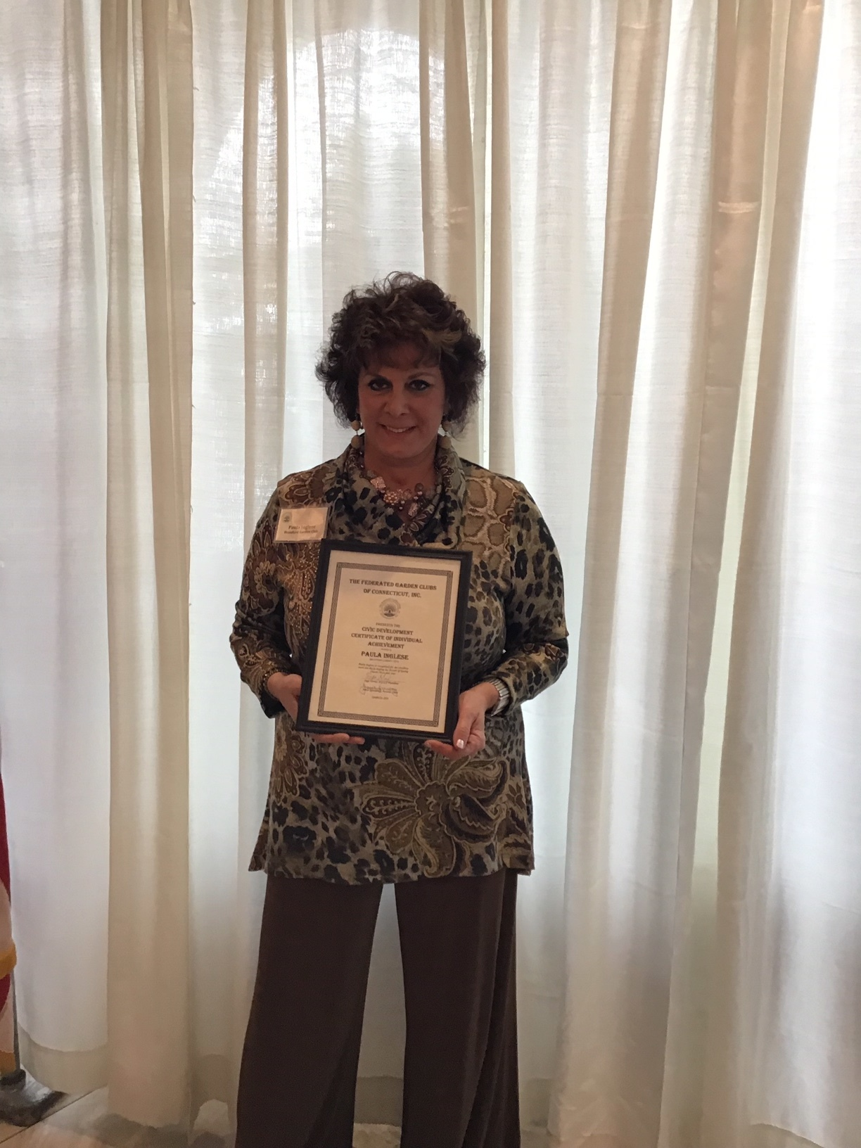 Paula Inglese received an Individual Certificate of Achievement, Civic Creativity Award, for her excellence and creativity in staging at the Breath of Spring Flower Show held in Hartford in February.