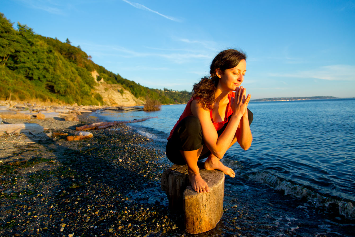 Lifestyle: Elizabeth Kovar practicing yoga on the beach at Discovery Park at sunset, Seattle