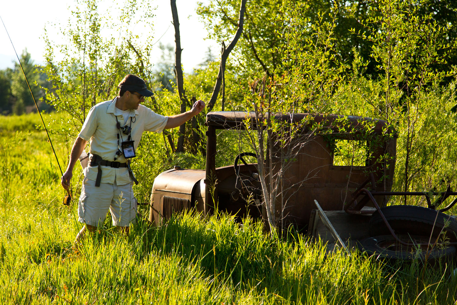 Lifestyle: Peter Sheetz exploring an old rusty truck while fly fishing, Carbondale, Colorado