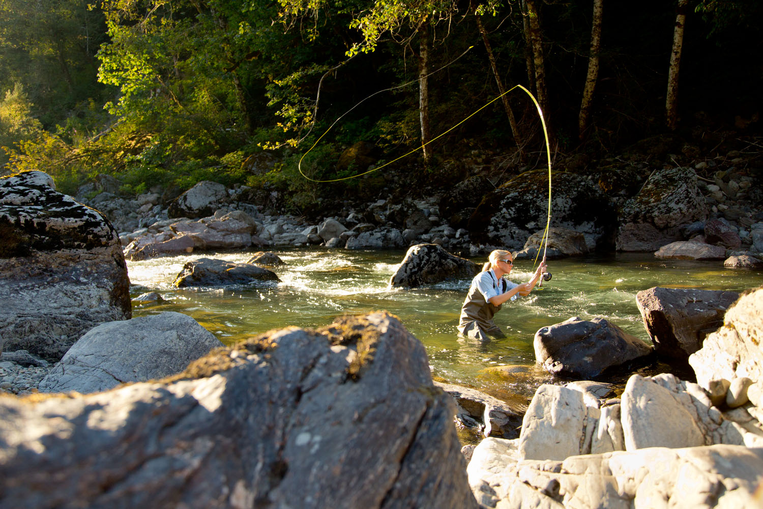 Lifestyle: Kathleen Hasenoerhl fly fishing on the South Fork of the Stillaguamish River in late summer, Central Cascades