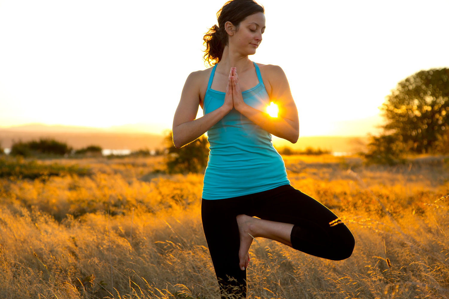 Lifestyle: Elizabeth Kovar practicing yoga in the Timothy grass at sunset, Discovery Park, Seattle