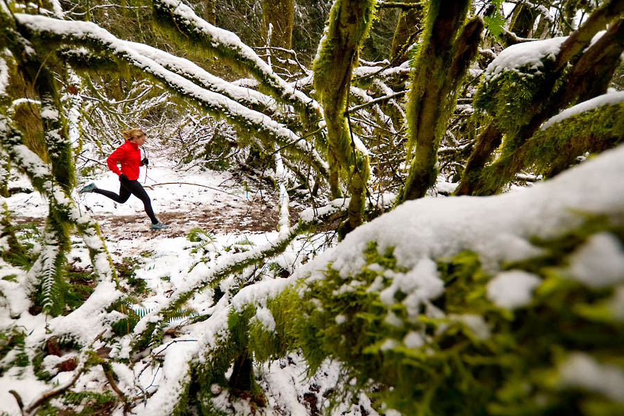 Maria Vucheva trail running in the snow, Tiger Mountain State Forest, Central Cascades, Washington