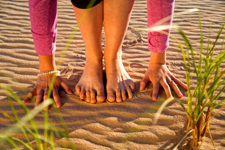 Lifestyle: Renee Clark and Jenn Haase practicing yoga at Sleeping Bear Dunes National Seashore in summer, Lower Peninsula, Michigan