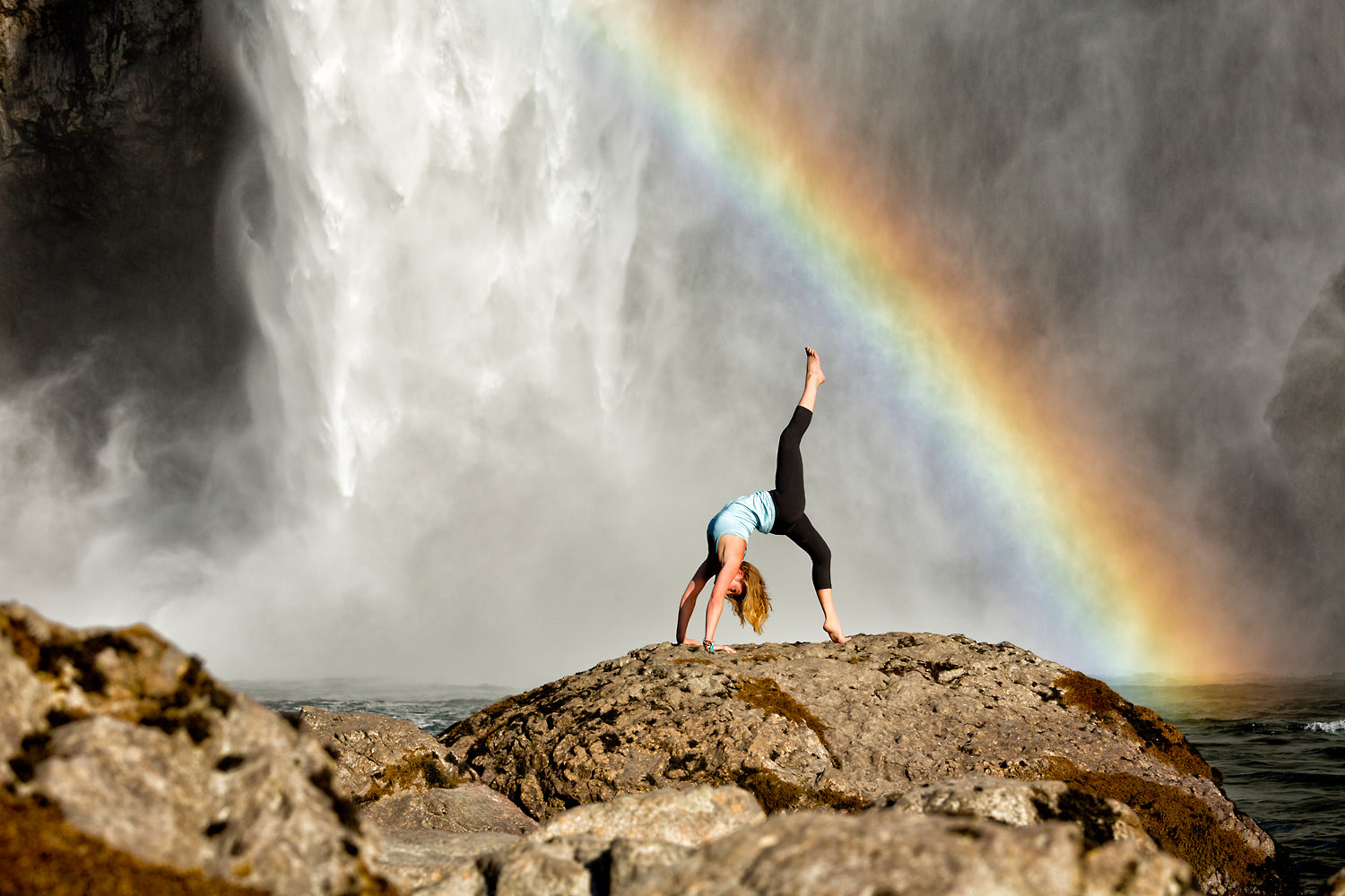 Lifestyle: Kristen Shaw practicing yoga below Snoqualmie Falls, Central Cascade Mountains, Washington