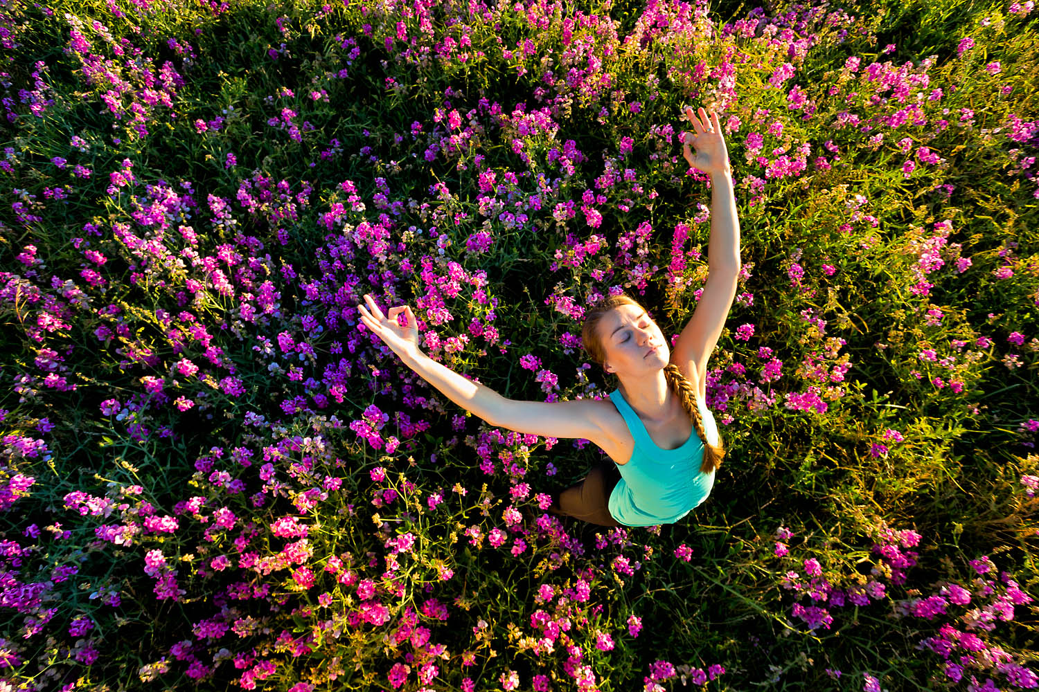 Lifestyle: Kirsten Dahlhauser practicing yoga in a meadow of wildflowers at Discovery Park, Seattle