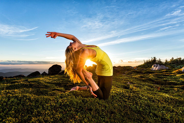 Lifestyle: Kristen Shaw practicing yoga in the wilderness of Mt. Rainier at sunset, Mt. Rainier National Park, Washington