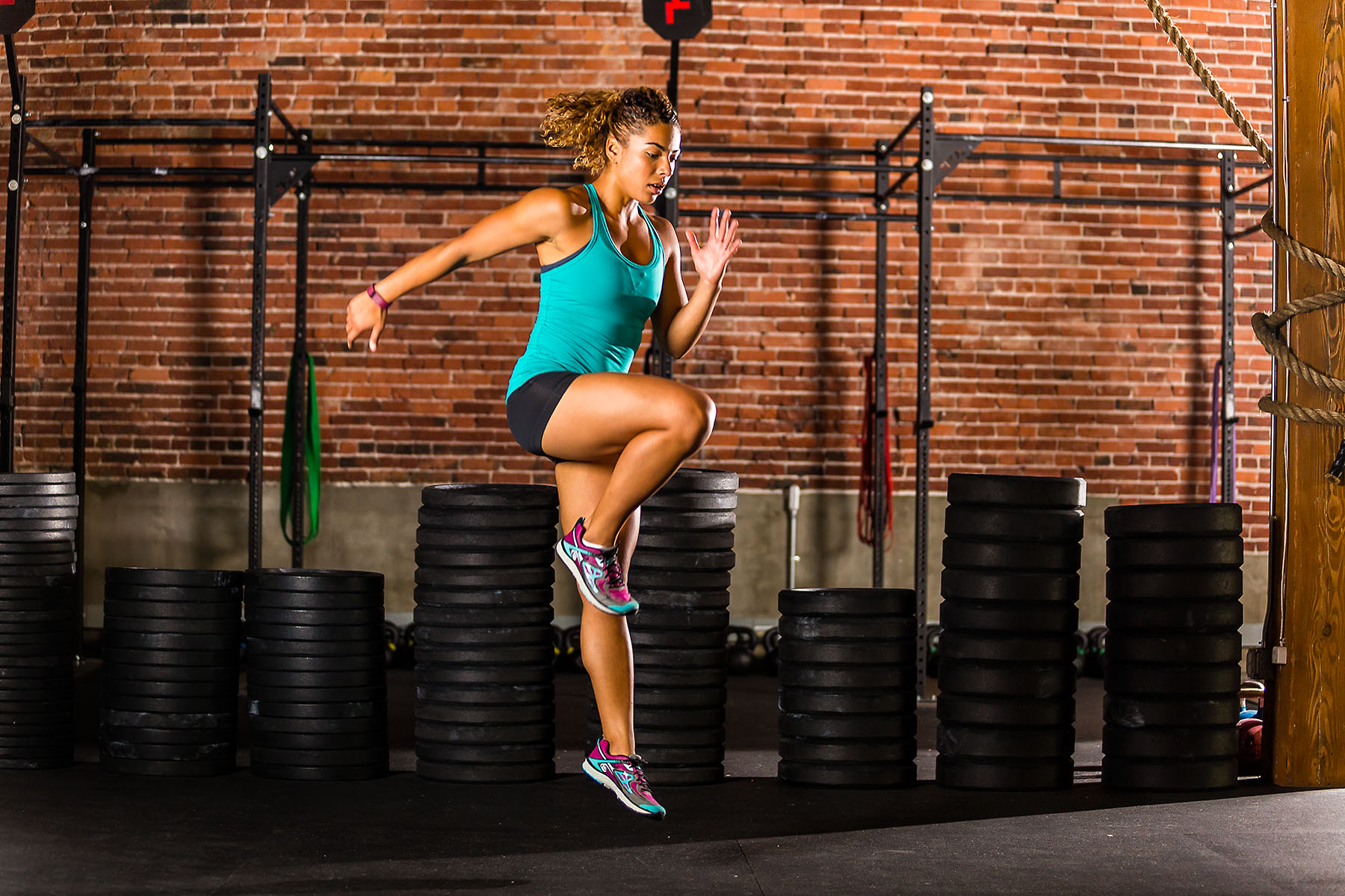 Fitness: Jennifer Forrester exercising at brick walled crossfit gym, Seattle