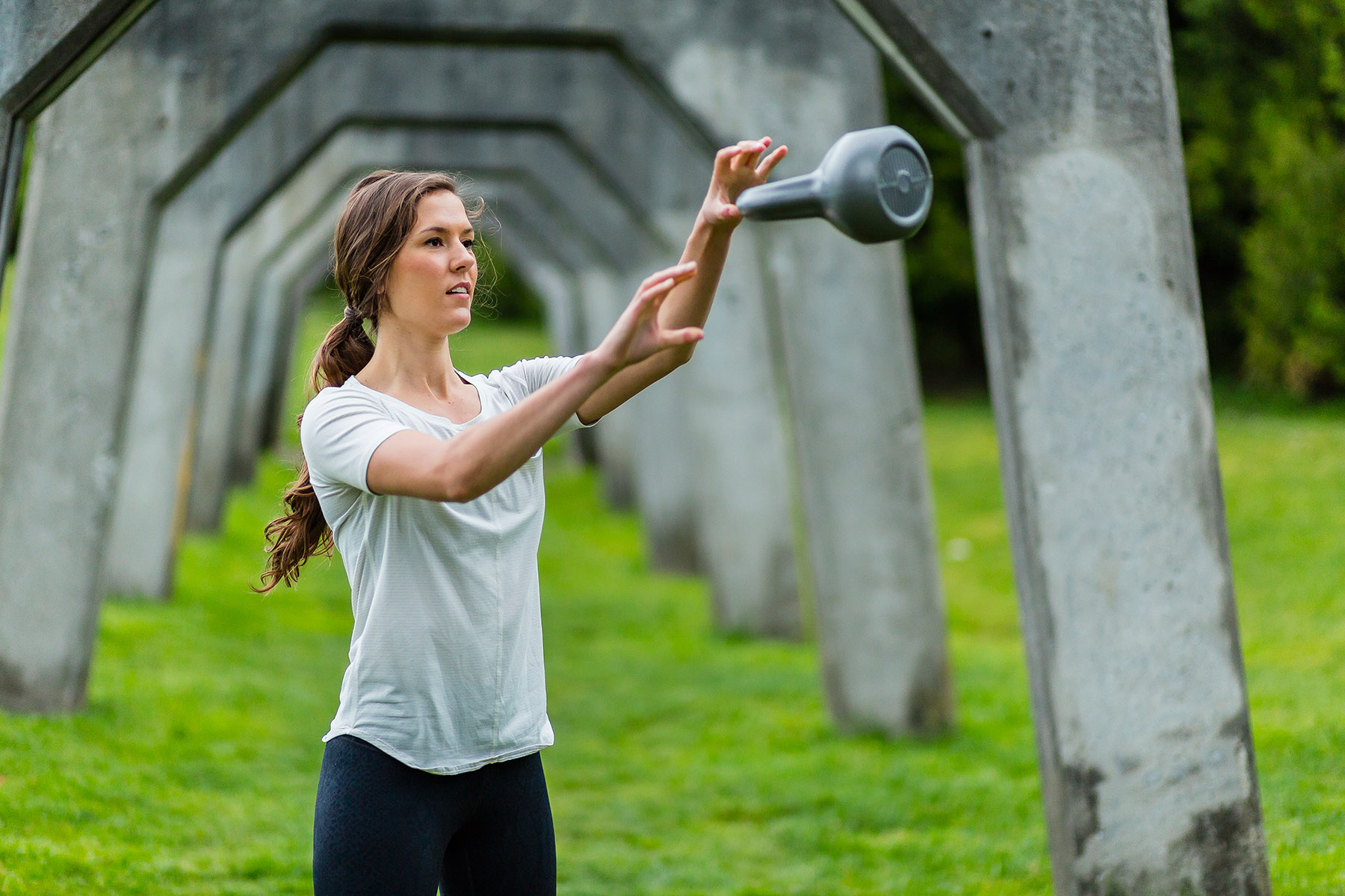 Fitness: Mary Little exercising with a kettle bell at Gas Works Park, Seattle, Washington