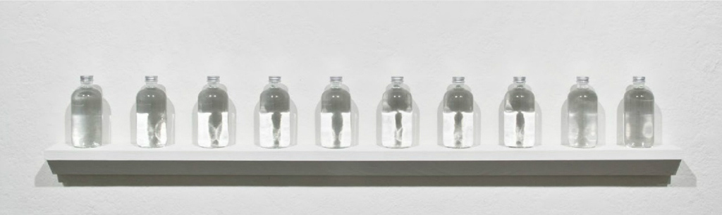 Material Dispersion . Structured Water for Los Angeles.8 ounces of purified spring water in a glass bottle sealed with an aluminum cap. Blessed each day for the duration of True Light. September 1 - December 1, 2012.