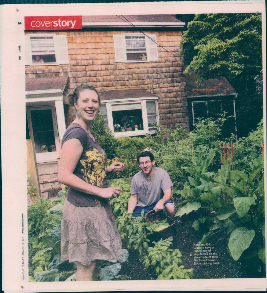 Kate and Eric Gilmore, harvesting basil in their front-yard HOGS raised bed.