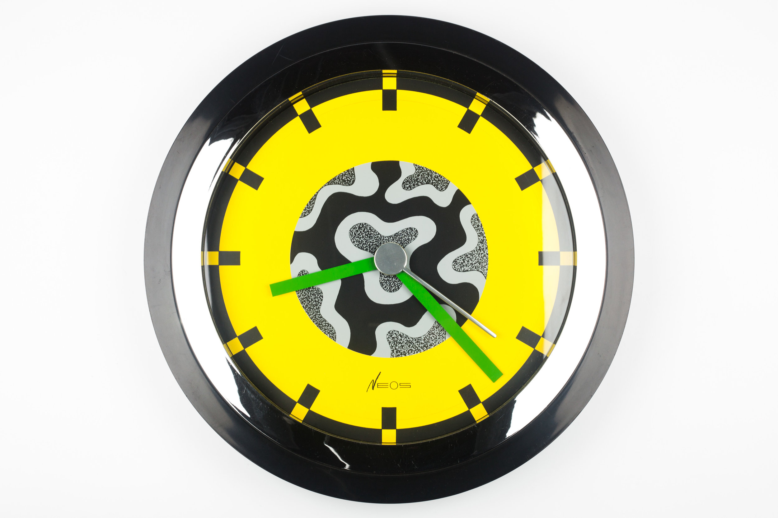 MEMPHIS WALL CLOCK CHROME, YELLOW BY DU PASQUIER AND SOWDEN X NEOS, ITALY, 1980S