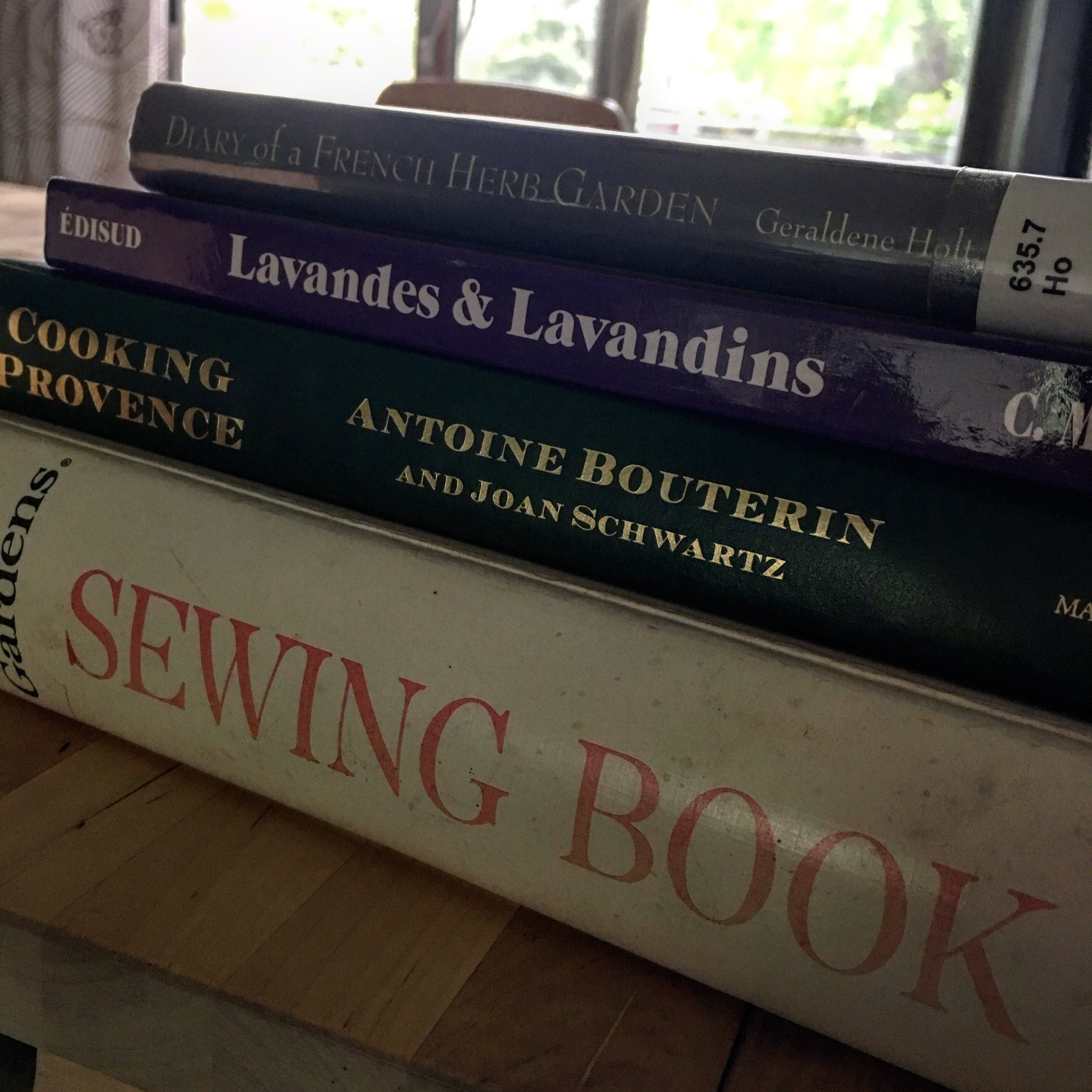 """I hit up the public library's Book Sale Day, which ended up being less a """"sale"""" & more """"giving away all the books for free."""" I got something to fuel each of my hobbies: French language maintenance,lavender growing, cooking, & sewing."""