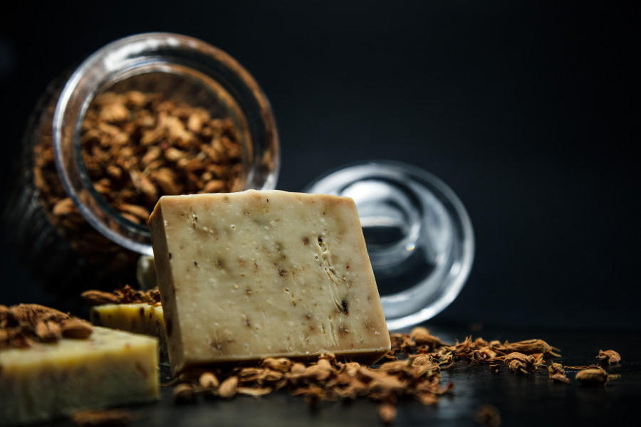 Handmade organic soap with coffee beans and a jar. Image by  Paul Gaudriault .