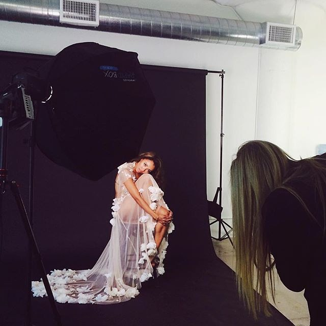 Kat Graham wearing Michelle Hébert, being photographed by Emily Soto
