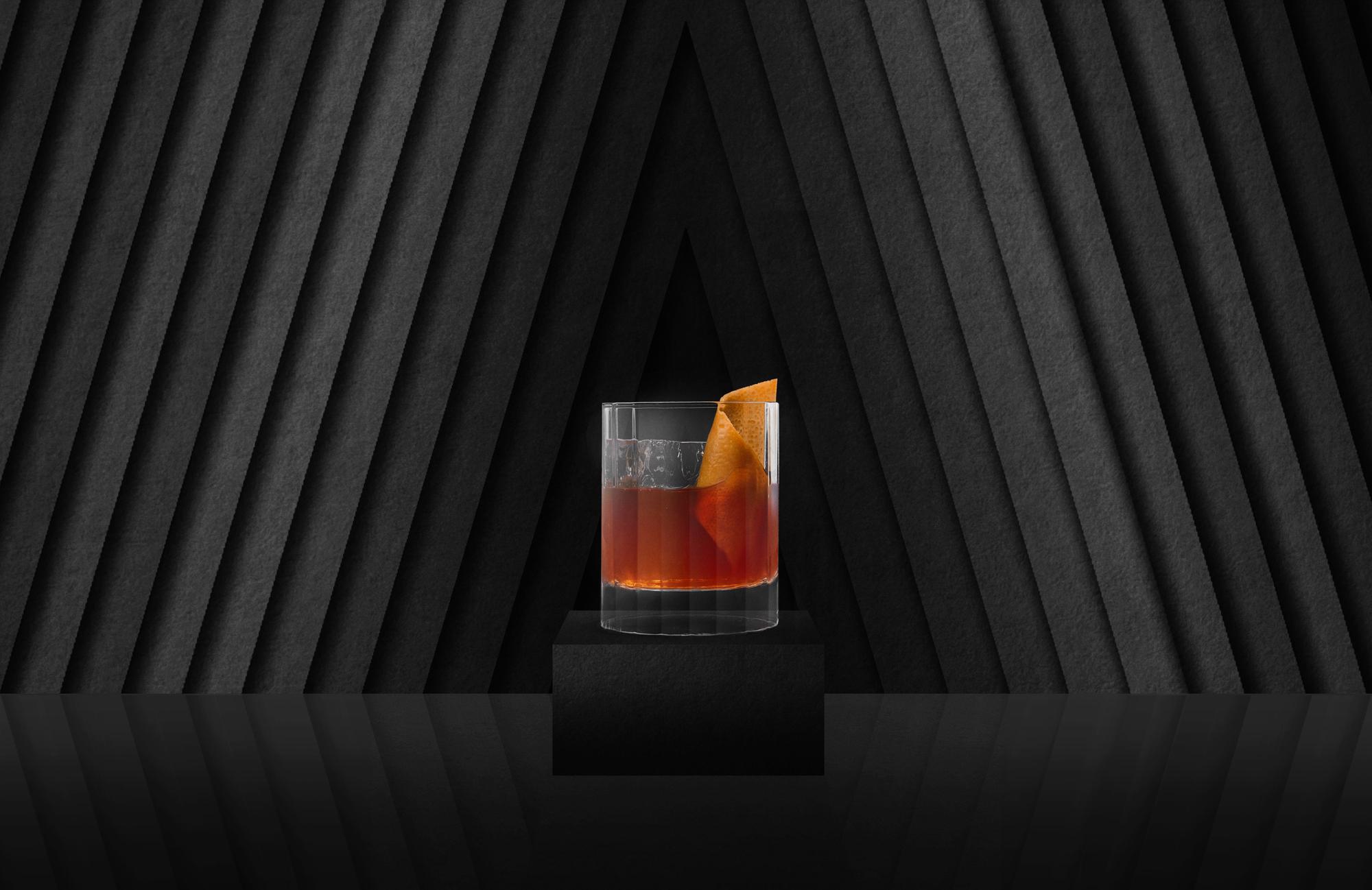 bottled cocktail glass on block black ad .jpg