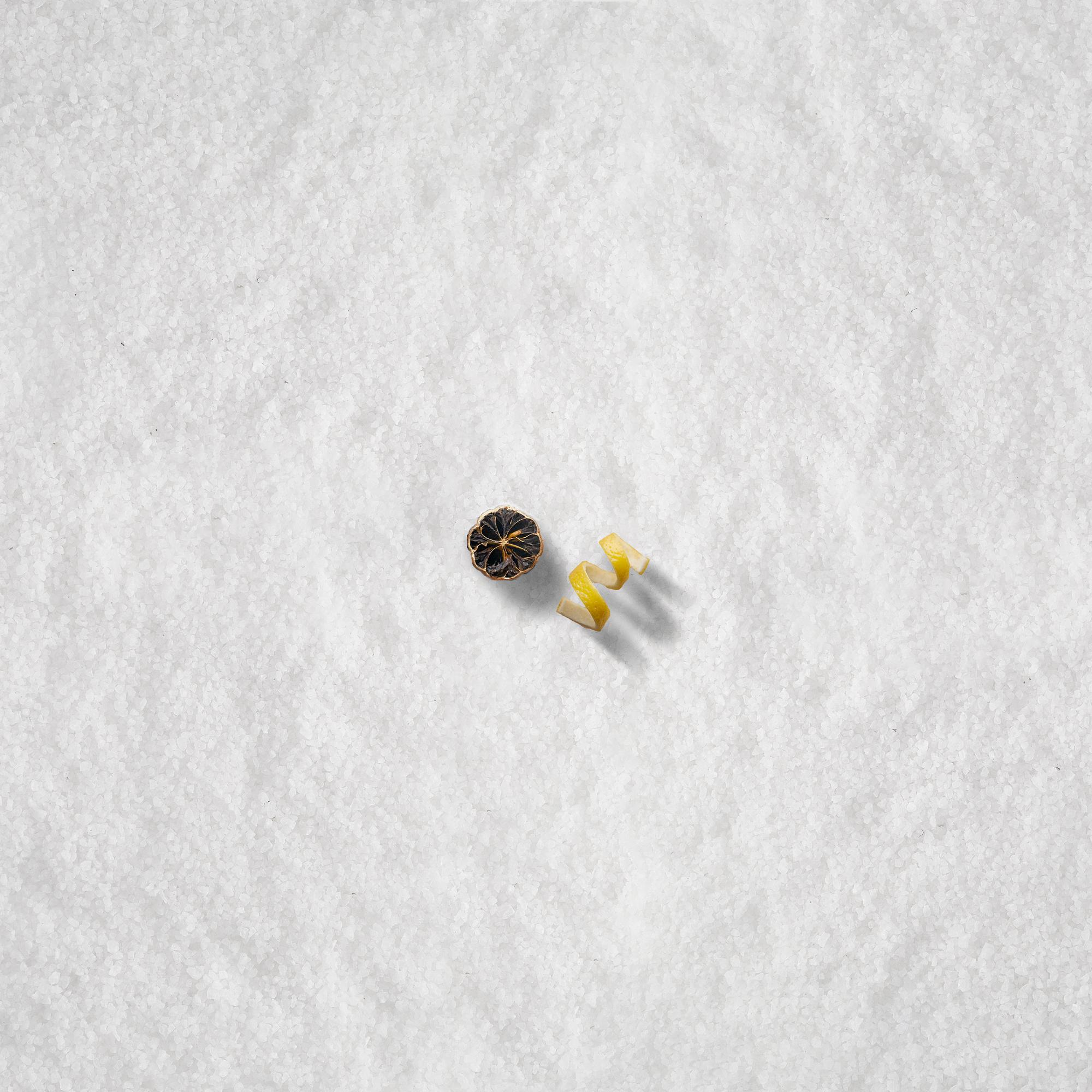 lemon peel and black lime on salt.jpg