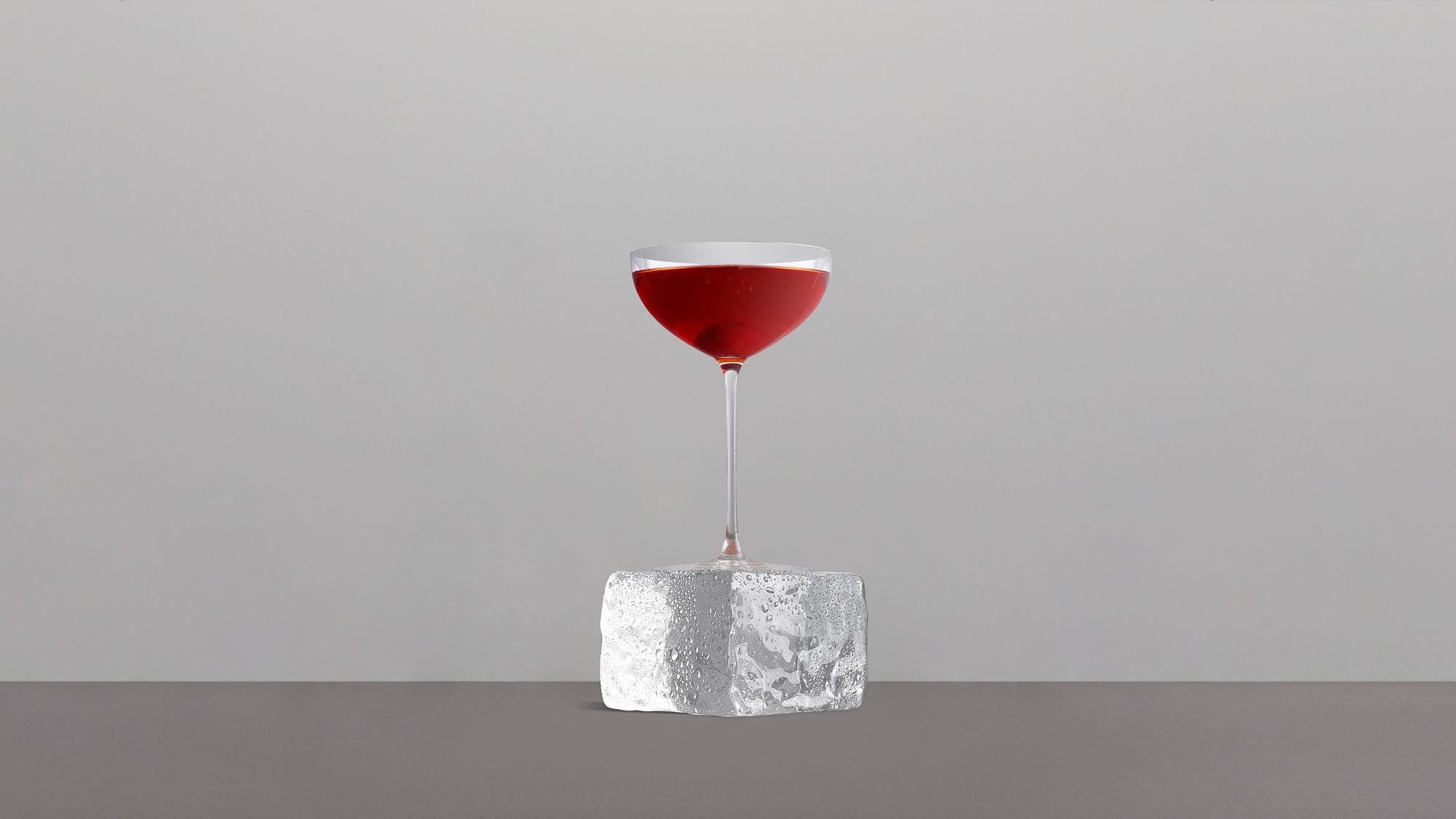 RED MANHATTAN cocktail glass ice block 16x9.jpg