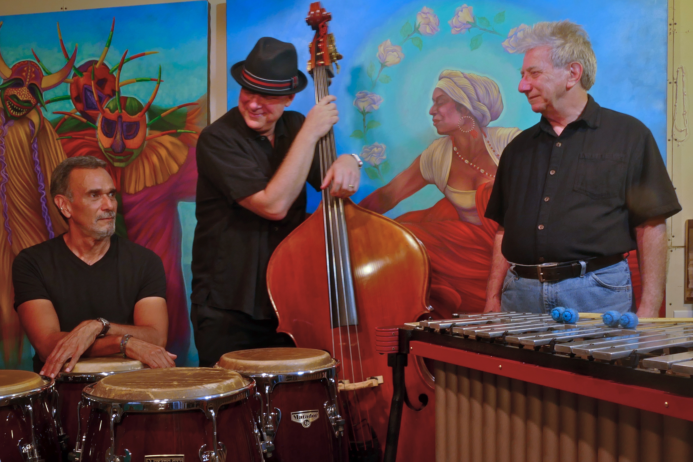 Sabor!Sabor! Latin Jazz Trio plays originals as well as Latin Jazz standards by masters such as Cal Tjader, Mongo Santamaria and Dizzy Gillespie. The line up is: Rick Altman on vibes, Michael Colletti on upright bass and Pablo Shine on Conga drums and percussion.This music, built on Afro-Caribbean grooves, is great for dancing!! Come out to celebrate Summer with us!!     I would like to give credit to the photographer,Amy Fenton-Shine (my wife).