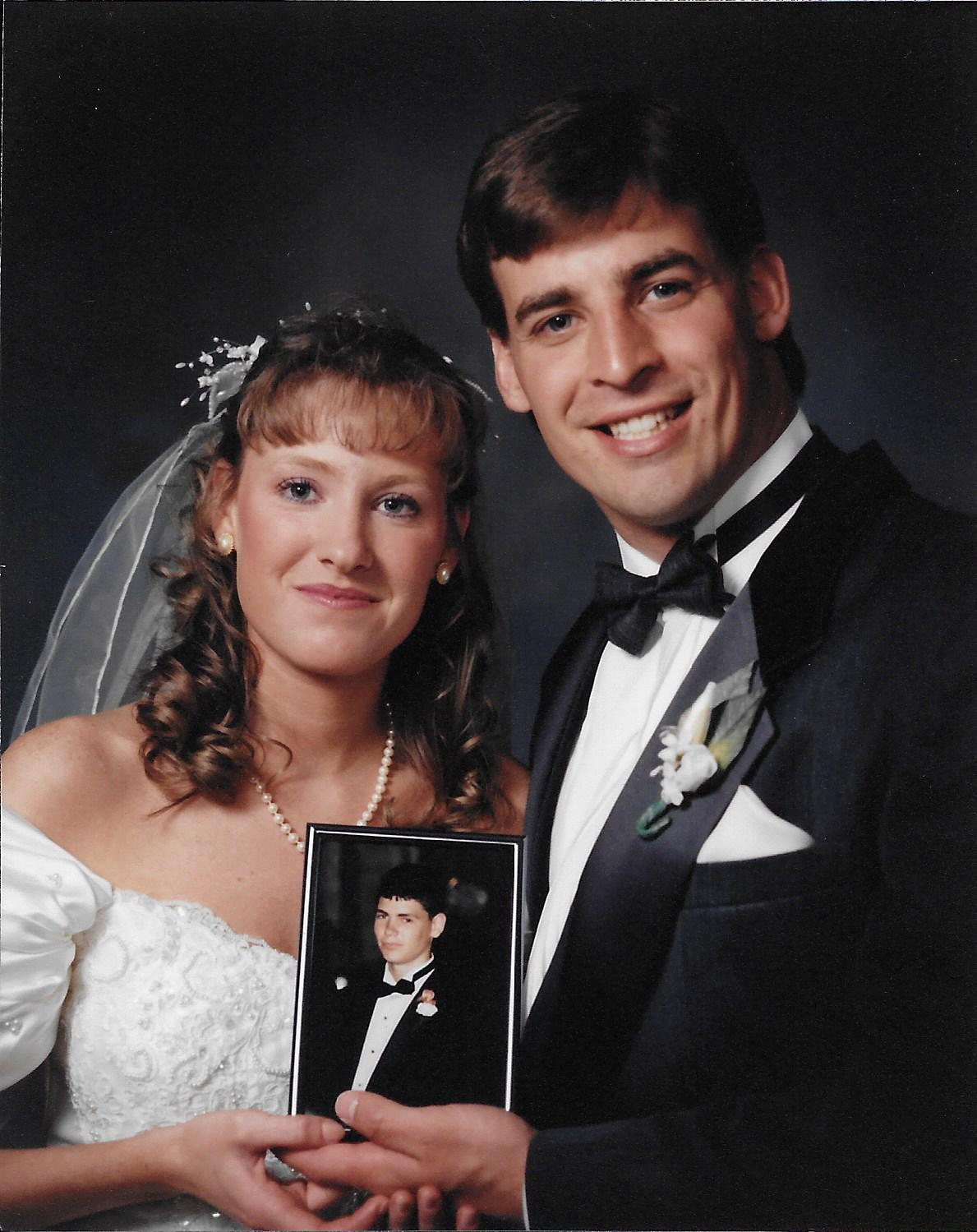 Kristin and Joe on their wedding day, 7 months after Adam passed away.