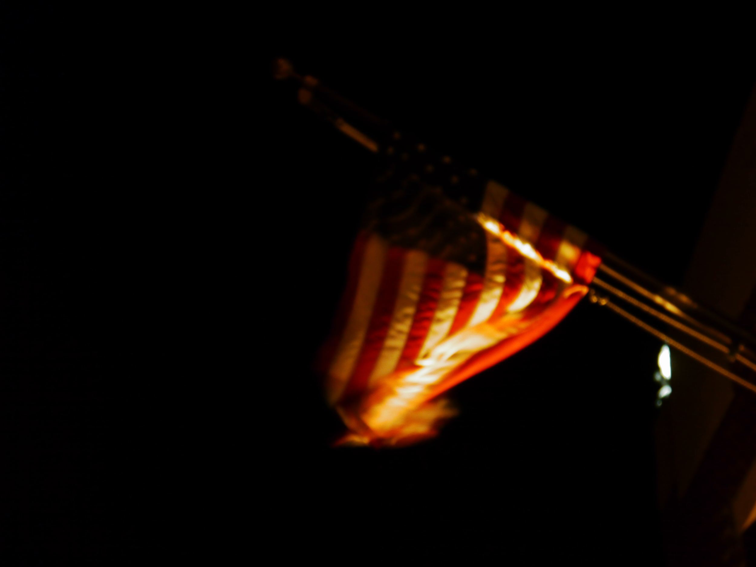 blurry flag in front of firehouse.JPG