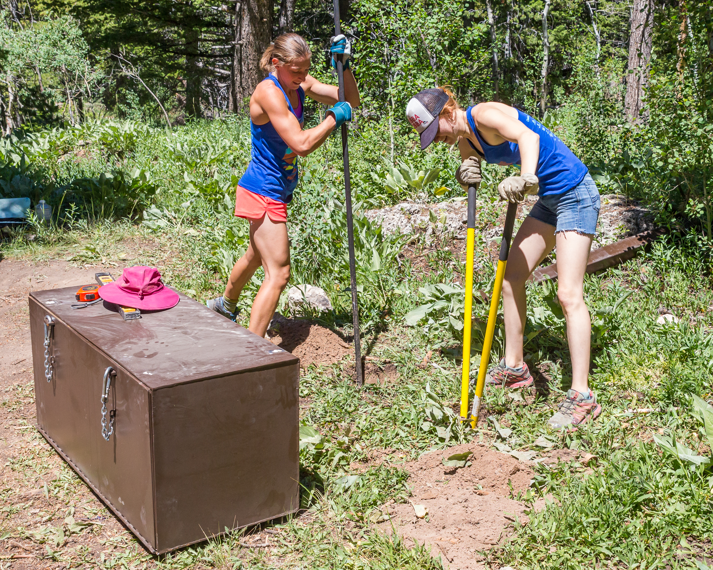 photo: Nathan R. Johnson. Volunteers installing Bear Boxes at the Wild Iris campground.