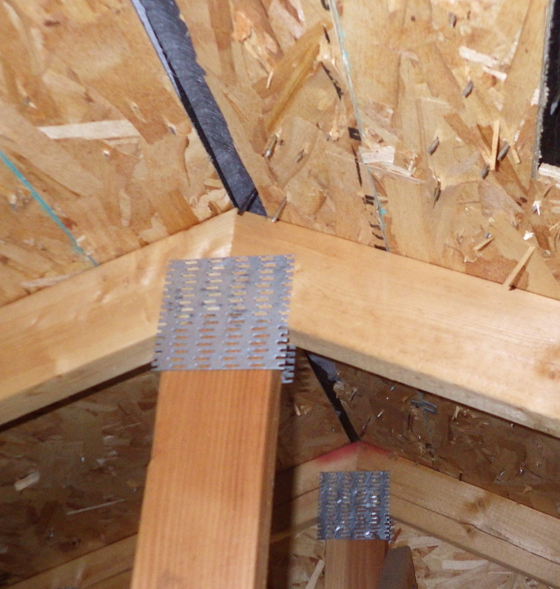 Ridge cut with less than an inch of opening, reducing the vent by a third.