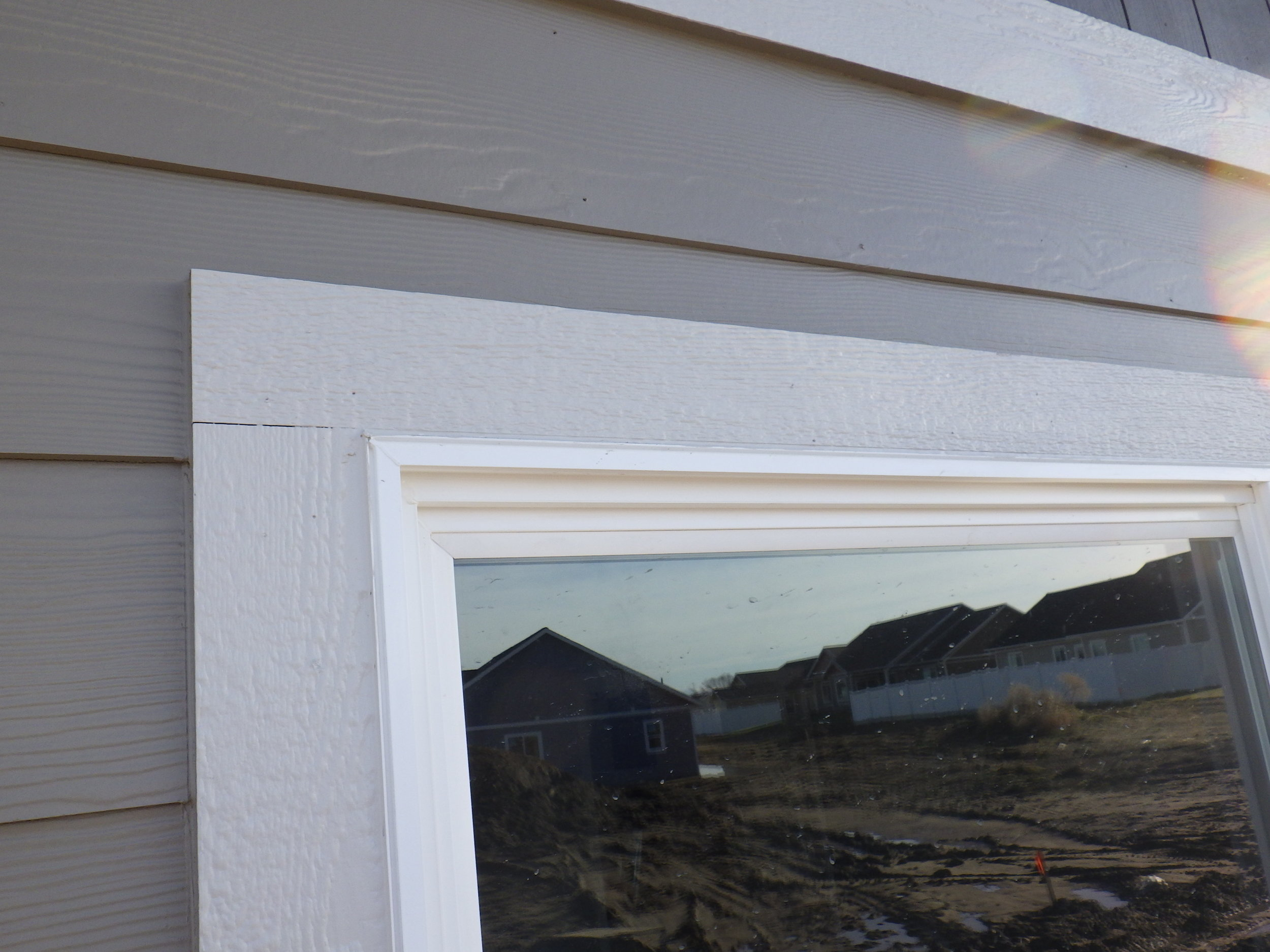 Flashing missing over this window trim