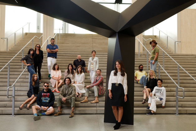 Back row, from left: Newbark designers Maryam and Marjan Malakpour (in sunglasses), Juan Carlos Obando, Esquivel designer George Esquivel (seated), Dosa designer Christina Kim and Nick Fouquet (in hat). Middle row: Clare Vivier, Anita Ko, Irene Neuwirth, Gregory Parkinson, the Elder Statesman designer Greg Chait (in yellow T-shirt), and L'Oeil du Vert perfumer Haley Alexander van Oosten (in black dress). Front row: Monique Lhuillier (in all black), Libertine designer Johnson Hartig, Greg Lauren, Free City designer Nina Garduno. Foreground: Katherine Ross, in front of Tony Smith's Smoke, 1967. Photography by Ye Rin Mok Styled by Ashley Furnival