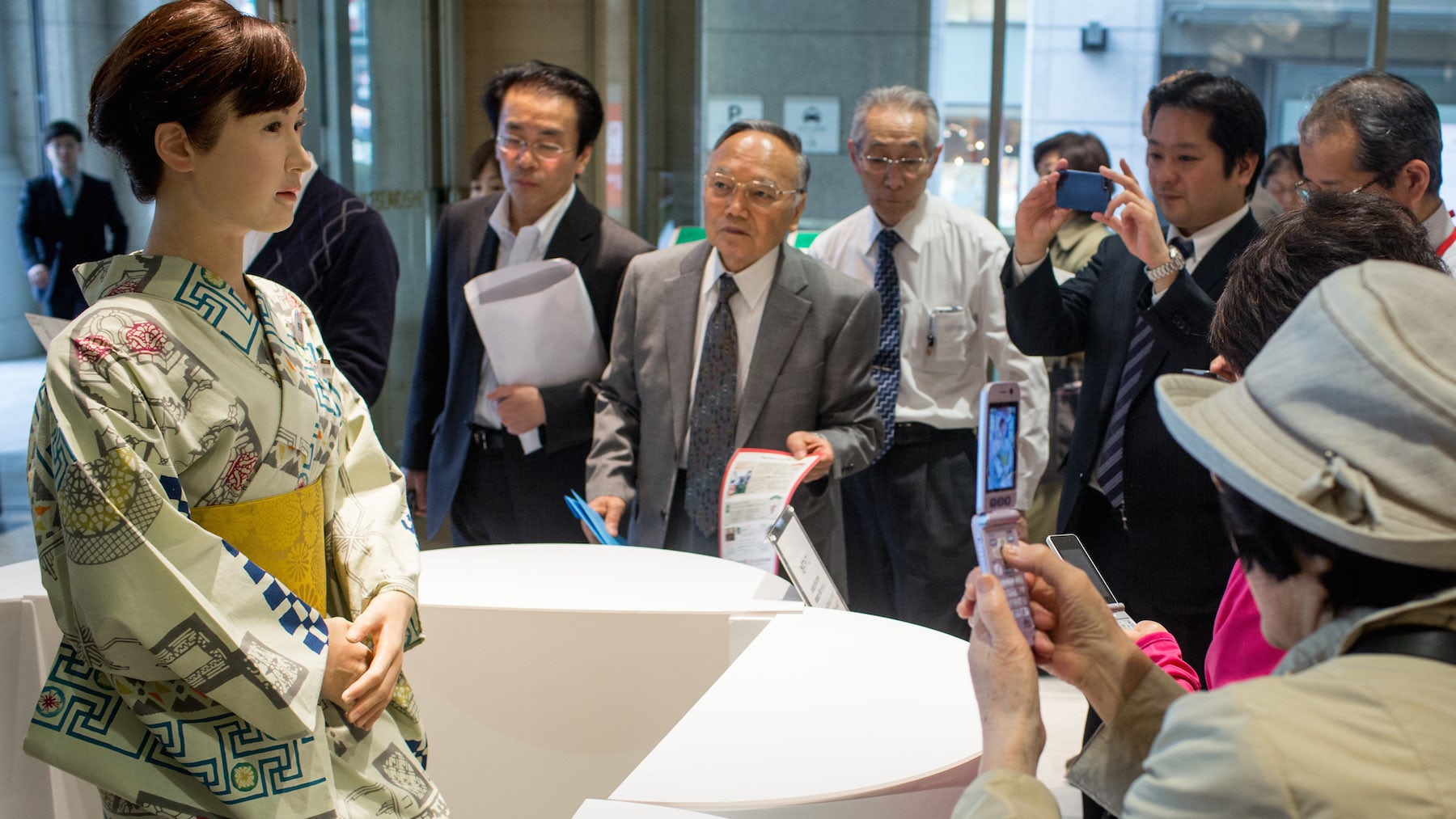 """Shoppers take photos of humanoid robot """"Aiko Chihira"""" at the Mitsukoshi department store 