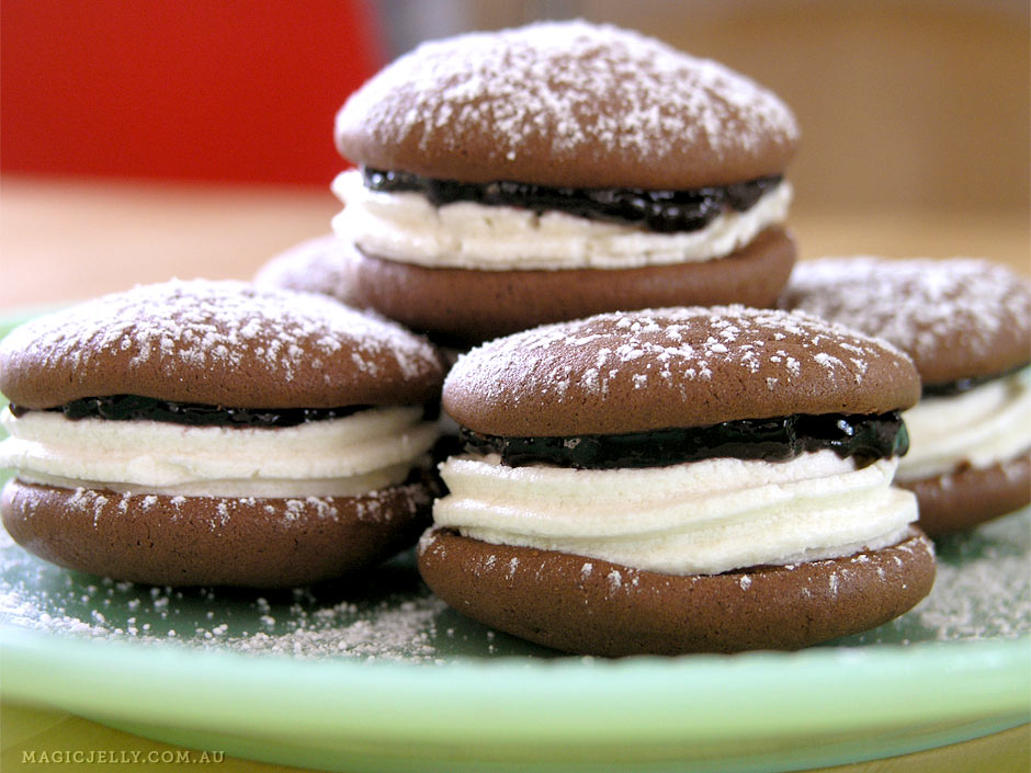Chocolate Whoopie Pies filled with blackberry jam & Firm Whipped Cream.