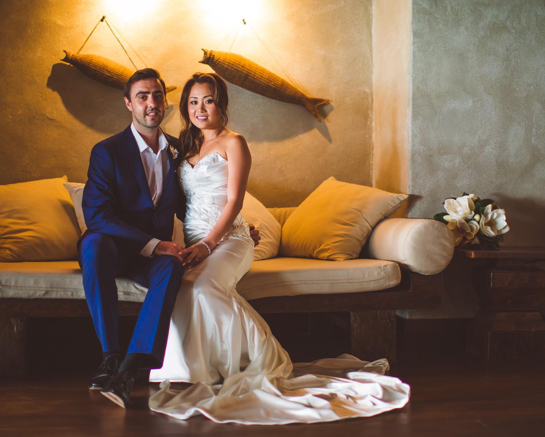 Aitutaki Wedding Bride and Groom sitting on a sofa