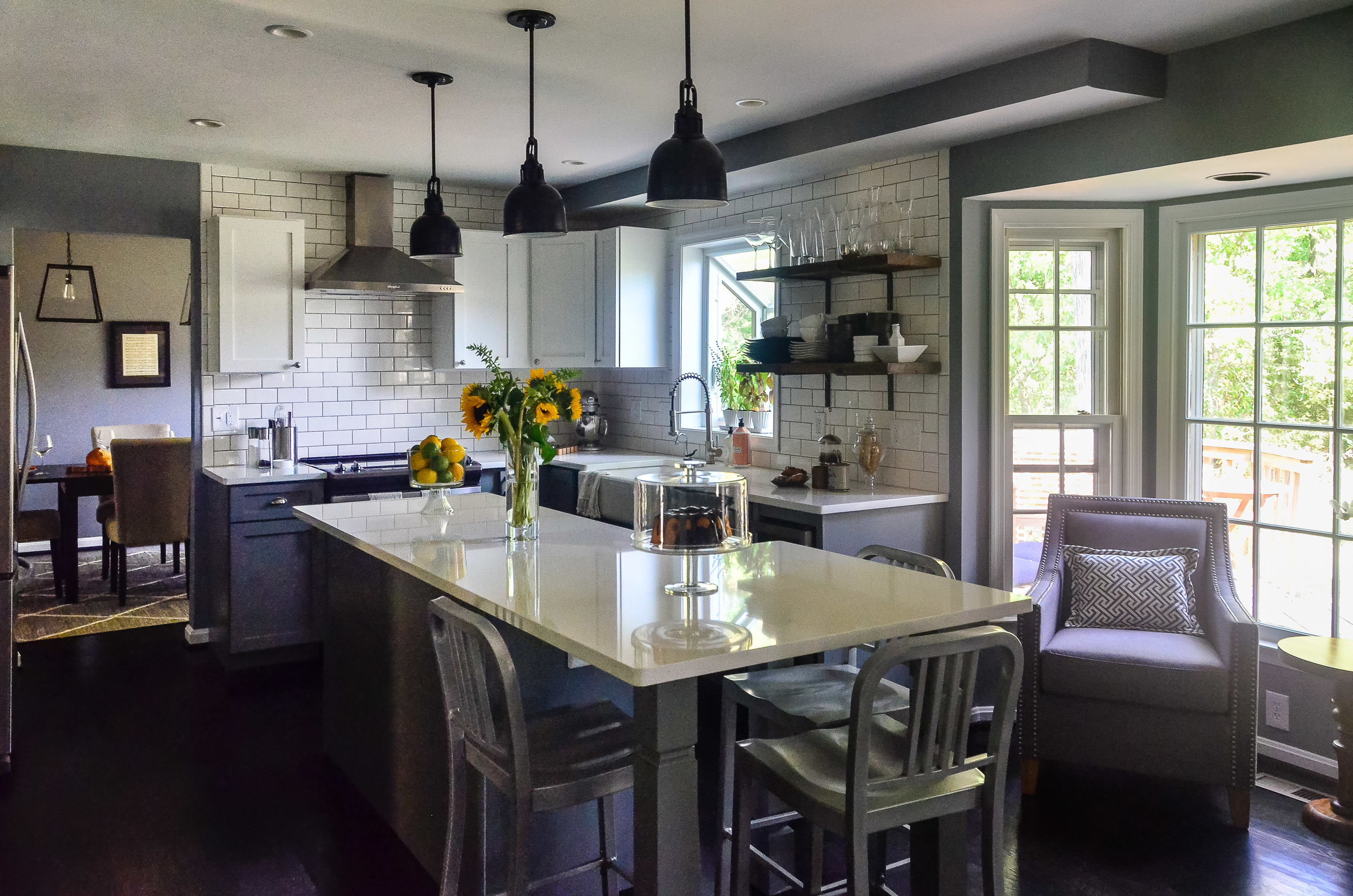 Selections that needed to be made to create this kitchen include cabinets, flooring, tile, grout, countertop, custom shelving/hardware, appliances, furniture, faucet, sink, paint, three styles of cabinet hardware and lighting.