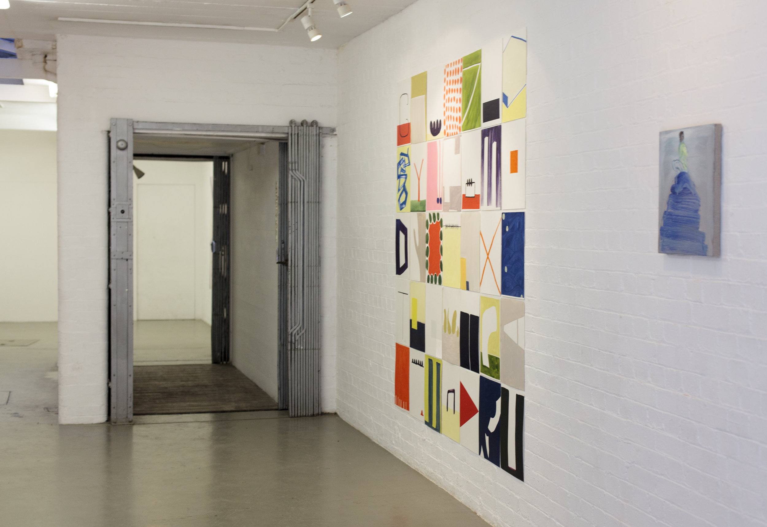 Installation view from  Lonely Long Feet - Standpoint London 2015 Left: Jessica Wilson All Untitled except third from left, second down titled  Long Feet Oil on paper, 210 x 240 cm Right: Sara Kerry  A lonely view over the entire world Oil on linen 41x36cm