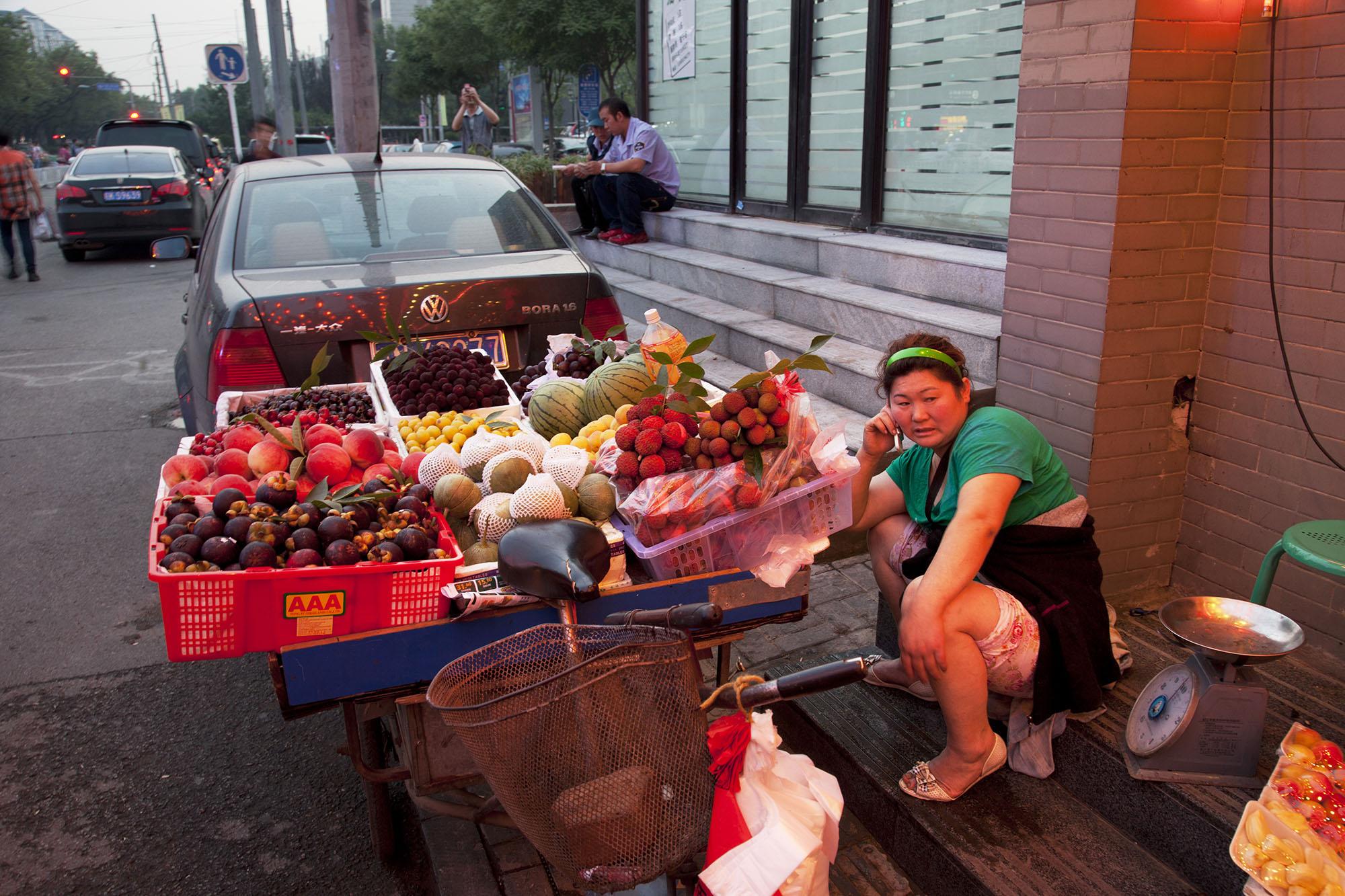 A fruit seller on Guijie food street.
