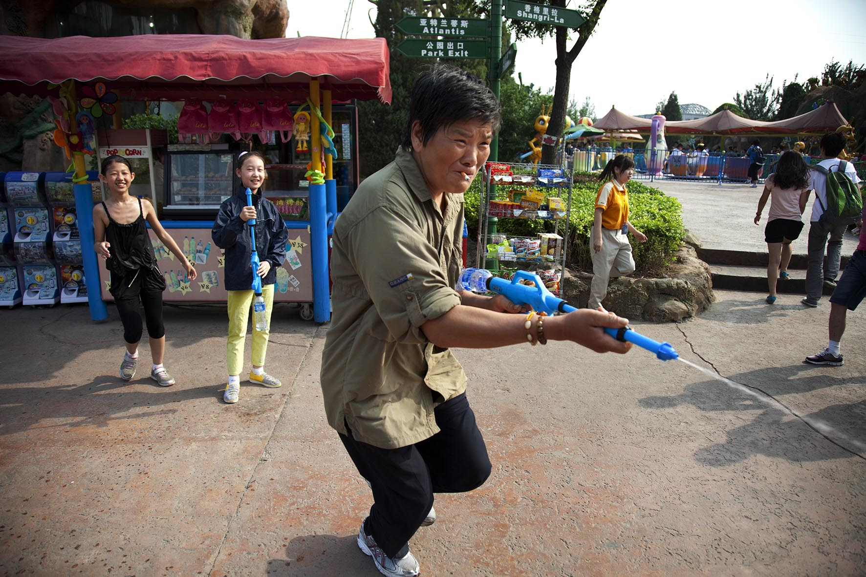 One parent joins in a water pistol fight at Happy Valley amusement park.