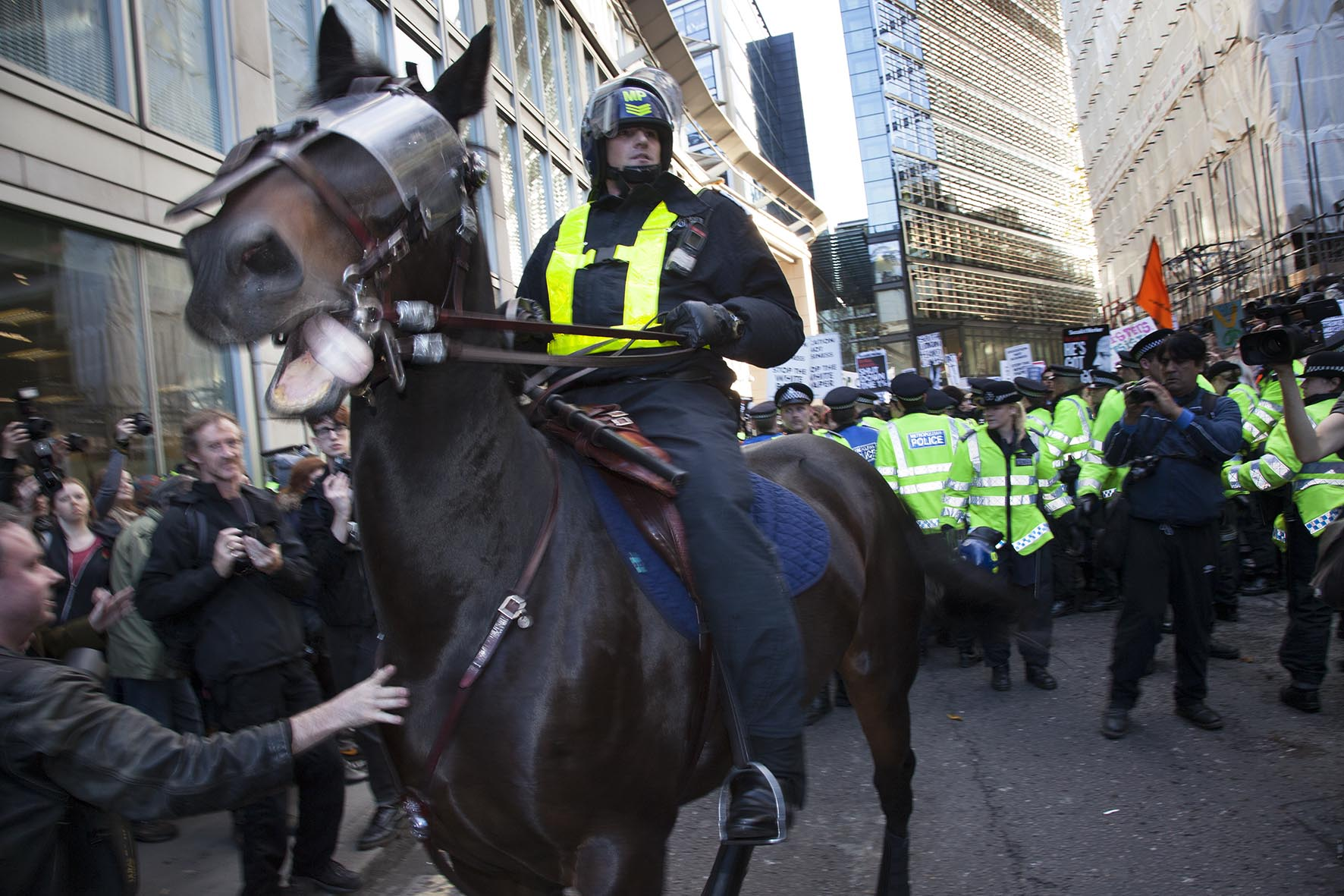Police horses in riot gear are deployed in The City of London as students march to protest against rises in tuition fees and changes to higher education.
