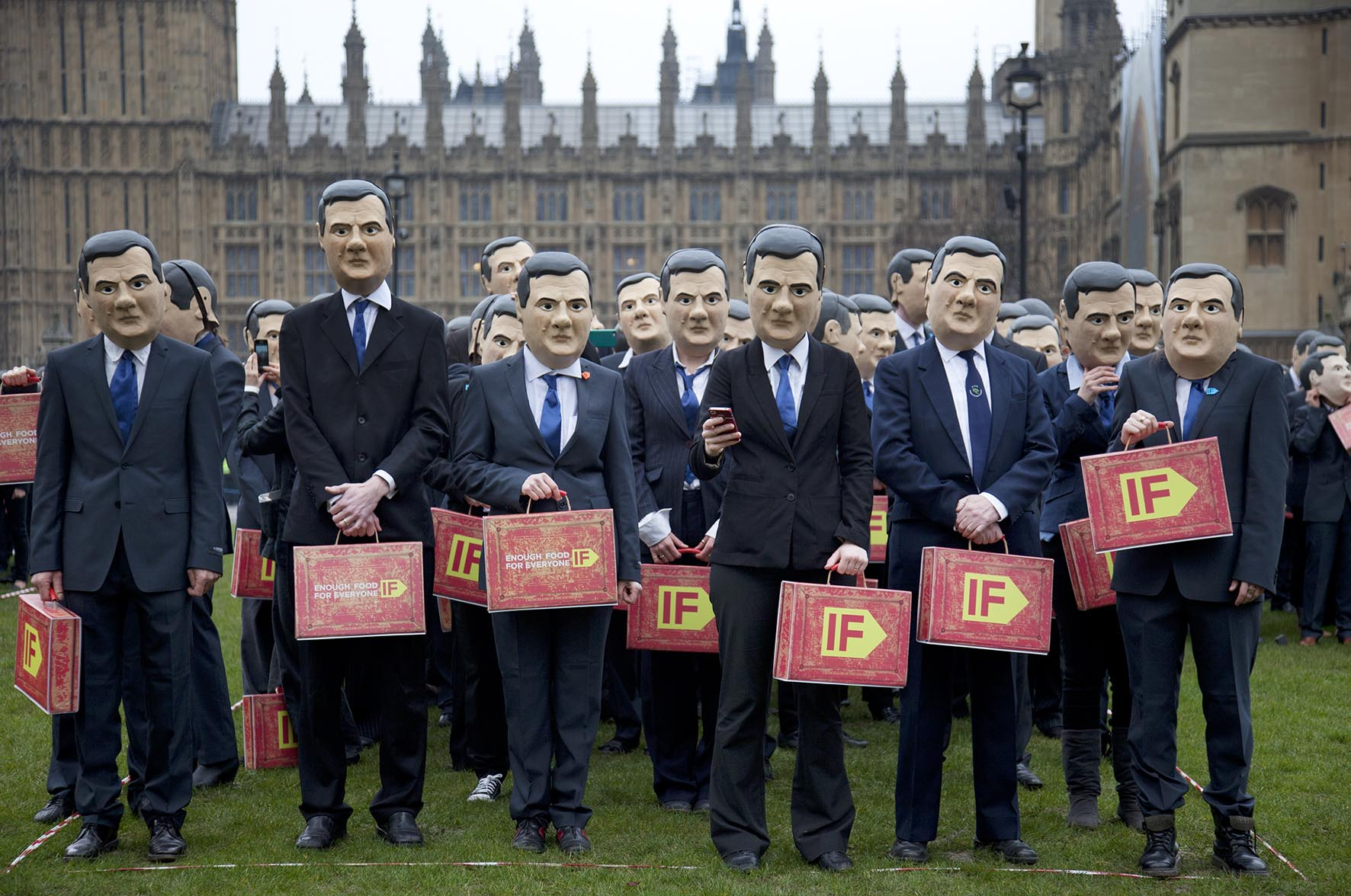 IF Campaign activists dressed as George Osborne gather in Westminster to remind the Chancellor to uphold aid promises and end tax dodging.