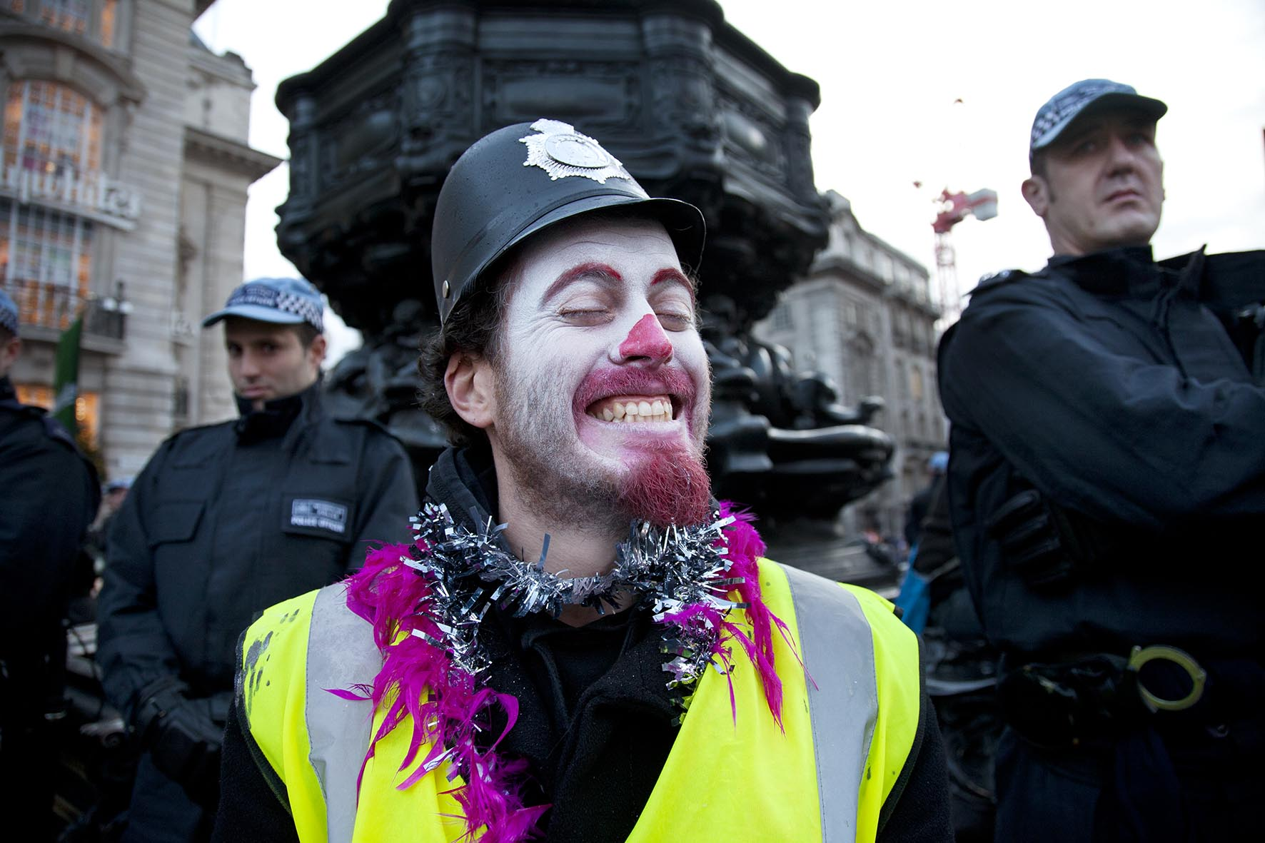 Anti-capitalist protester dressed as a police clown splits off from the main N30 protest and demonstrated at Piccadiully Circus.