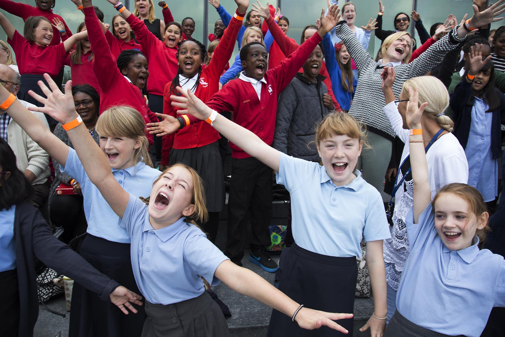 Thames Festival 2014. Kids choir sing at The Scoop.  For Totally Thames.