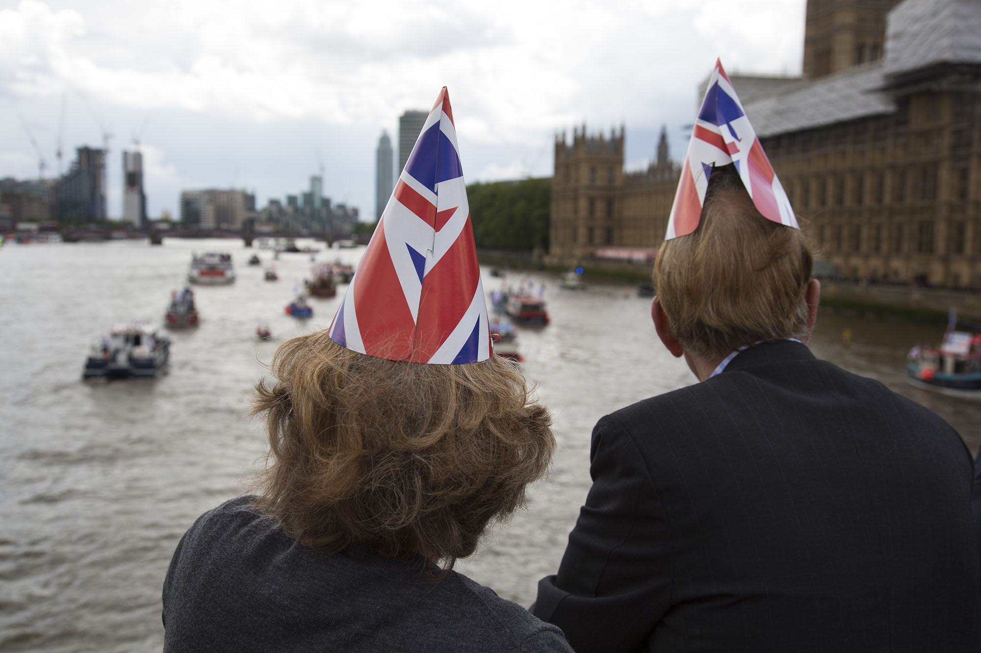 Flotilla of fishing vessels arrive outside Parliament, as protesters gather to cheer them on as part of the Vote Leave Campaign.