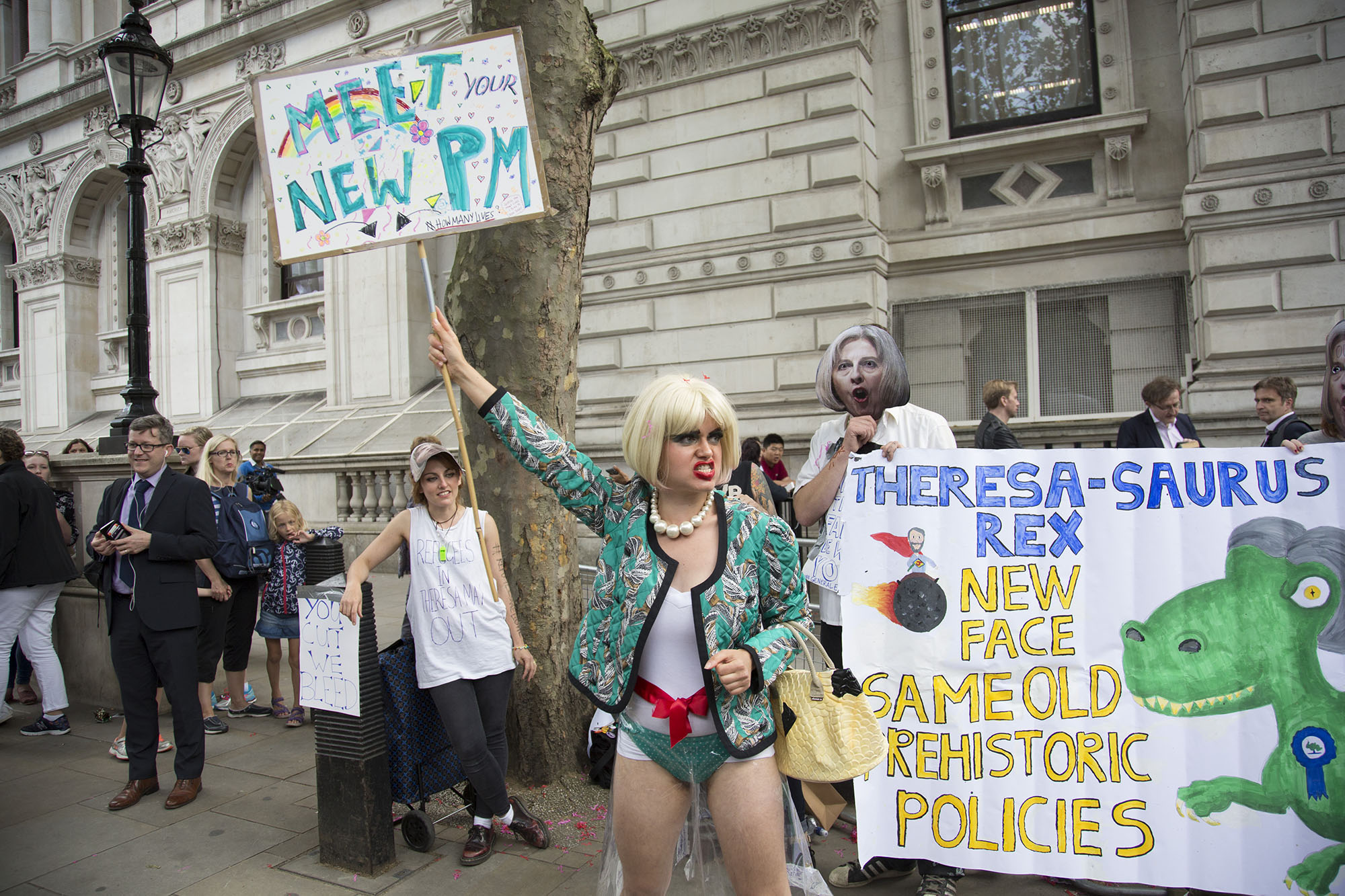 On the day Theresa May MP became Prime Minister, protesters dressed up singing political songs mocking the PM outside Downing Street.