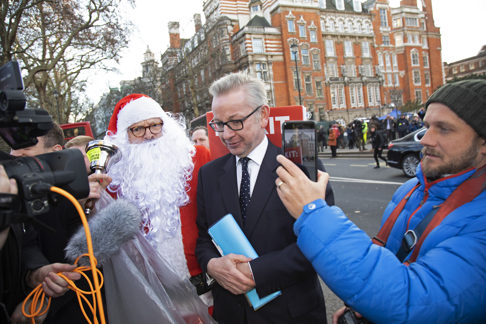 Anti Brexit demonstrator dressed up as Santa confronts Michael Gove MP shouting at him that he doesn't understand the needs and lives of ordinary people on the day that Conservative Party MPs triggered a vote of no confidence in the Prime Minister Theresa May.