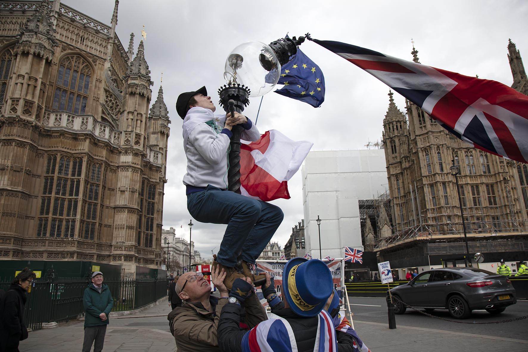 Brexit protesters attempt to rescue a falling street lamp in a scene reminiscent of Raising the Flag on Iwo Jima, the iconic photograph taken by Joe Rosenthal, in Westminster on 4th April 2019.